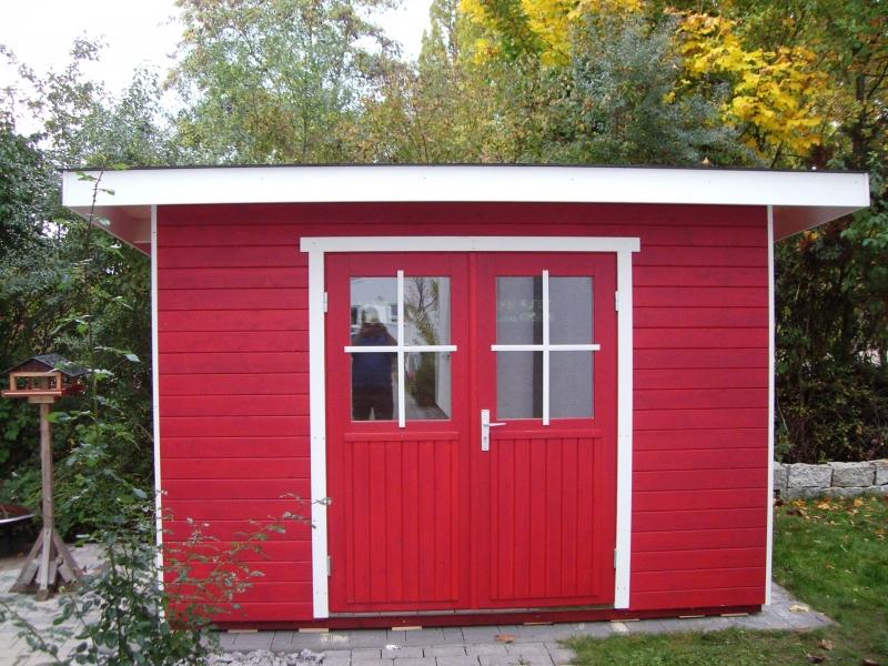 Pultdachhaus in der Lasur schwedenrot-weiß